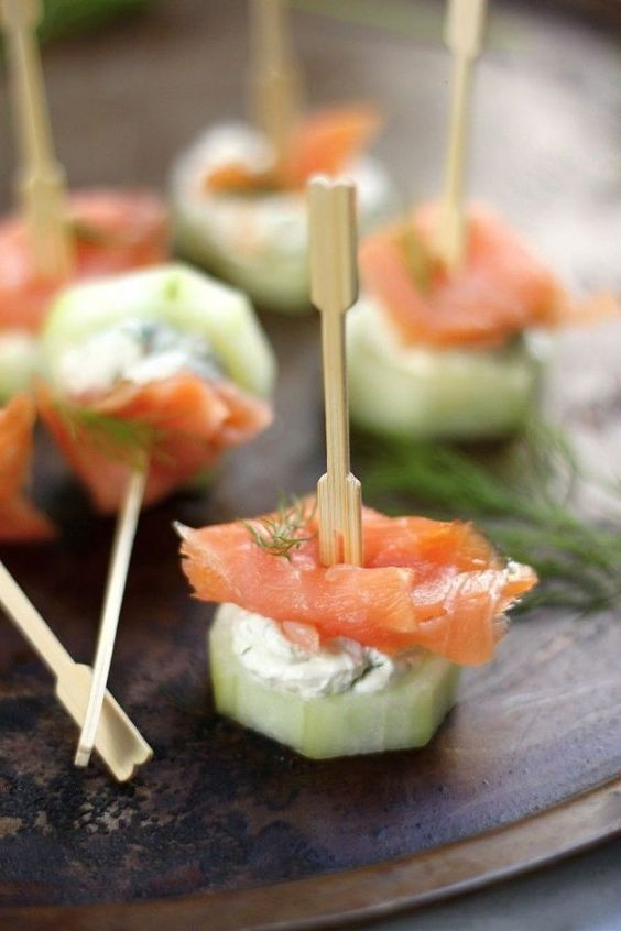 fresh cucumber slice plus cream cheese and salmon is a tasty appetizer idea for any season