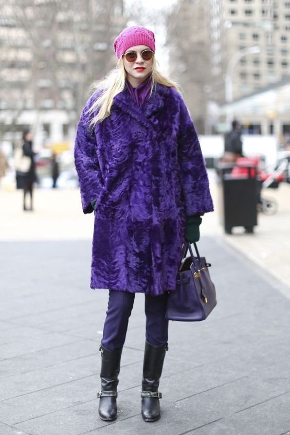 a bold ultraviolet fur coat, pants, boots and a pink beanie for a colorful winter look