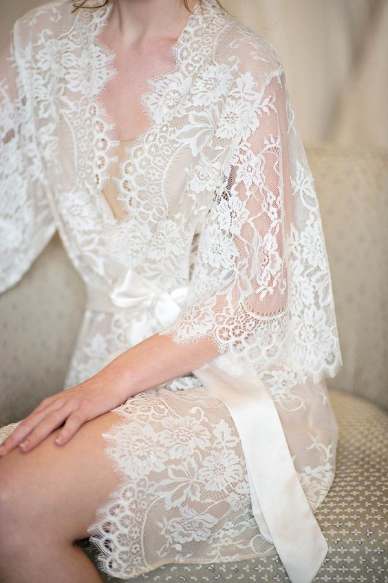 a refined white lace bridal robe with bell sleeves and a silk sash looks wow