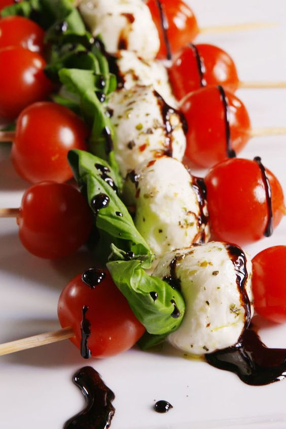 skewers with cherry tomatoes, arugula, mozzarella and balsamic drizzle are always a good idea