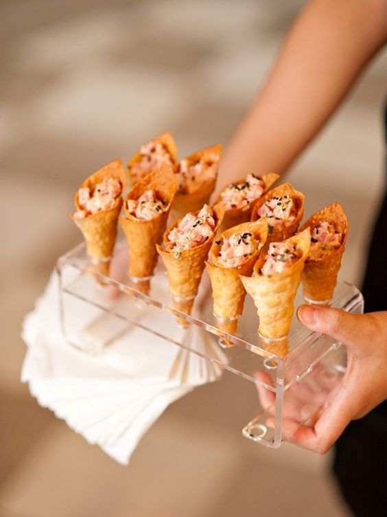 spicy tuna served in wonton ice cream cones with toasted black sesame seeds is a creative idea