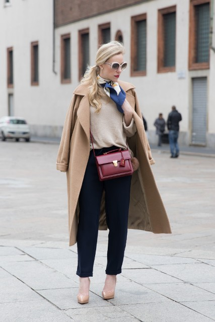 With beige shirt, camel midi coat, trousers, beige pumps and marsala bag