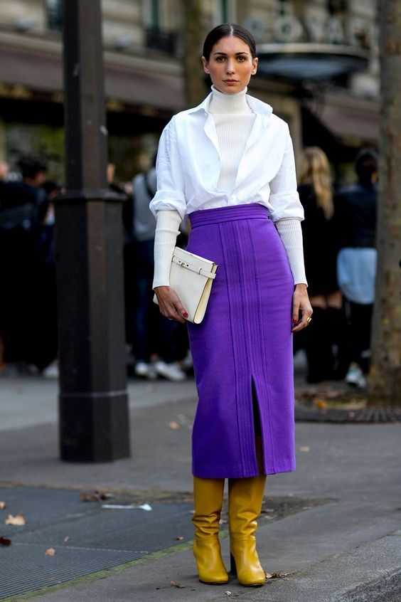 yellow boots, an ultraviolet midi skirt with a slit, a white shirt and a sweater