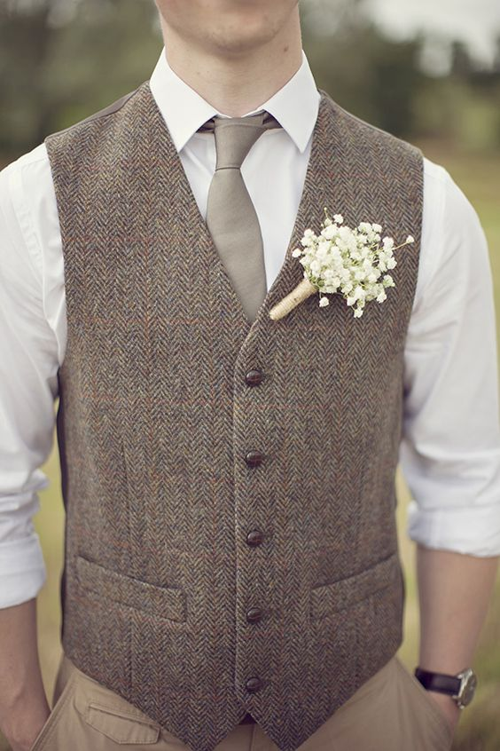 tan pants, a white shirt, a grey tie and a brown waistcoat
