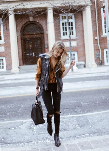 With brown shirt, skinny pants, ankle boots and tote
