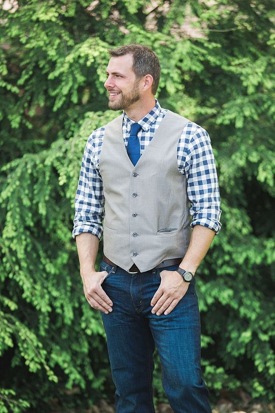 jeans, a plaid shirt in blue, a grey waistcoat and a bold blue tie for a country wedding