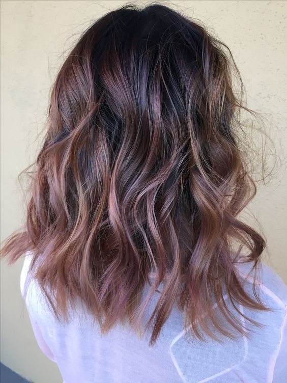 a dark root with rose gold balayage for an interesting look