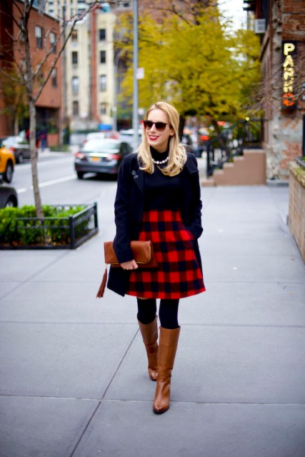 With black shirt, brown high boots, brown clutch and black jacket