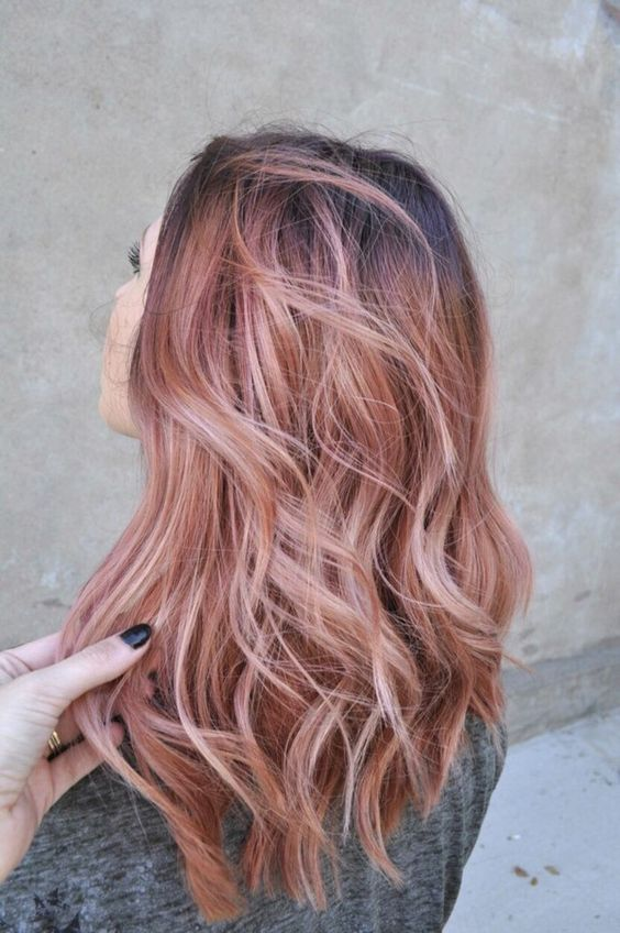 blonde hair and rose gold highlights with waves for a non-typical look