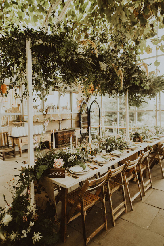 The reception was in a cheese shop, it was decorated with lush greenery and florals all over