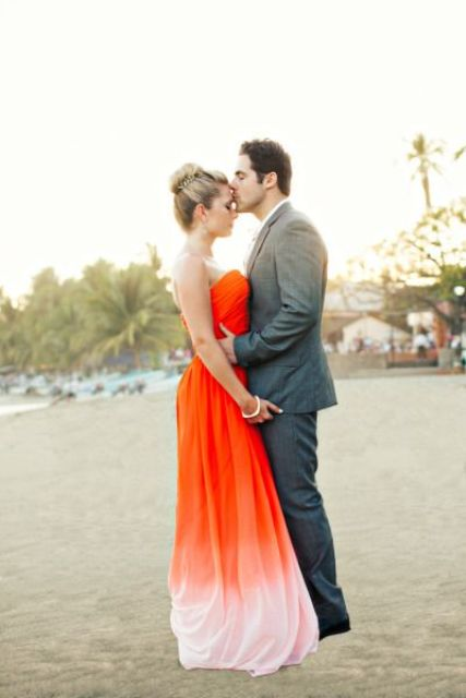 a statement strapless orange wedding dress going to peachy shade on the skirt