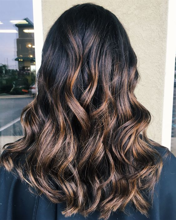 black hair with chic brown and chestnut balayage for a softer look