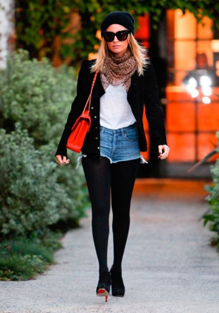With white t-shirt, black tights, black beanie, heels, printed scarf, red bag and black jacket