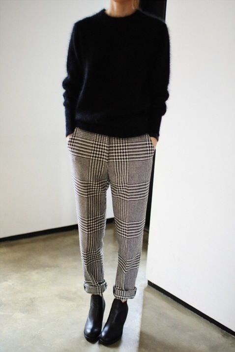 checked trousers, a black cashmere sweater and black booties for the office