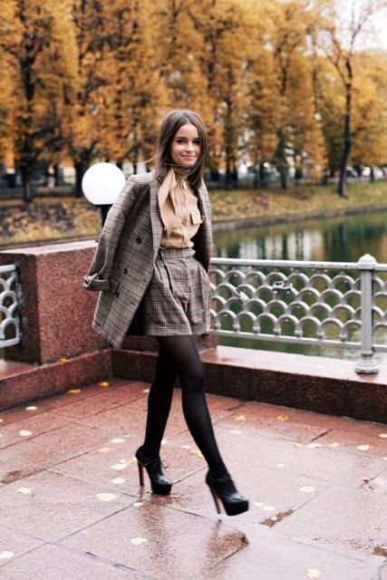 With brown blouse, tweed blazer, black tights and ankle boots