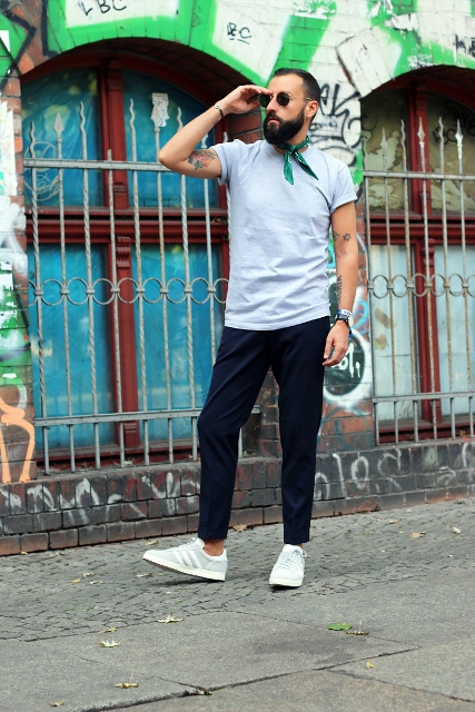 With t-shirt, black pants, white sneakers and sunglasses