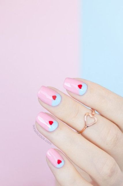 a lunar manicure in pastel pink and blue plus little red hearts