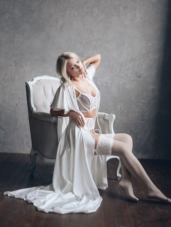 a white silk long bridal robe with short ruffled sleeves and wedding lingerie under it is ideal for a bridal morning