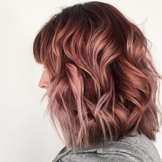dark brunette hair with lots of rose gold highlights for a soft and eye-catchy look