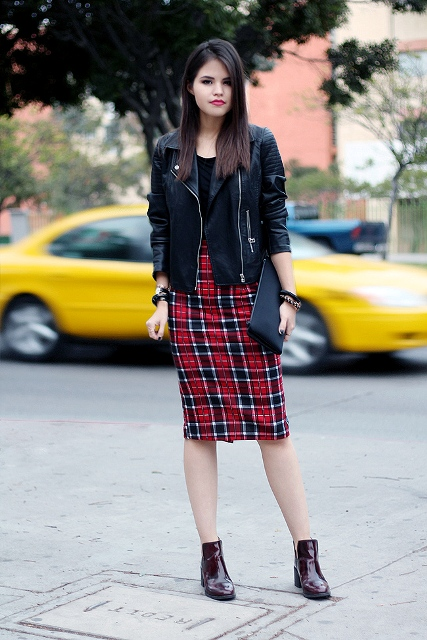 With black shirt, black leather jacket, marsala boots and clutch