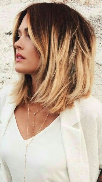 a textural bob, black roots, warm blonde to caramel edges for a sunburnt look