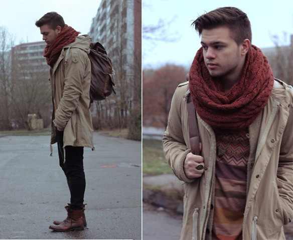 With sweater, pants, brown boots, parka coat and backpack