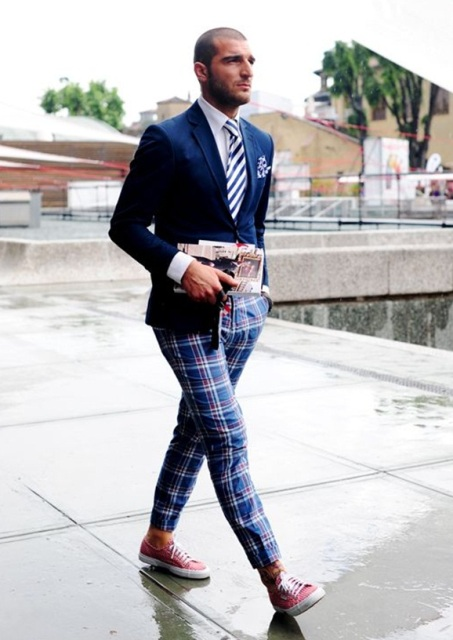 With navy blue blazer, striped tie and pink sneakers