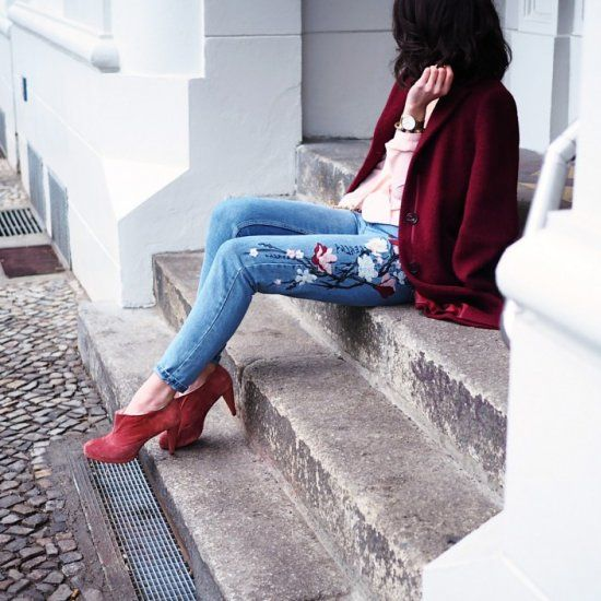 floral jeans, coral booties, a pink shirt and a marsala coat