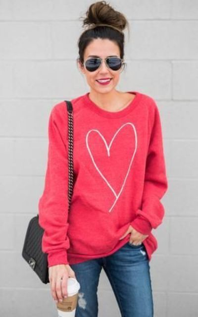 ripped jeans, a pink heart sweatshirt is all you need for a comfy look