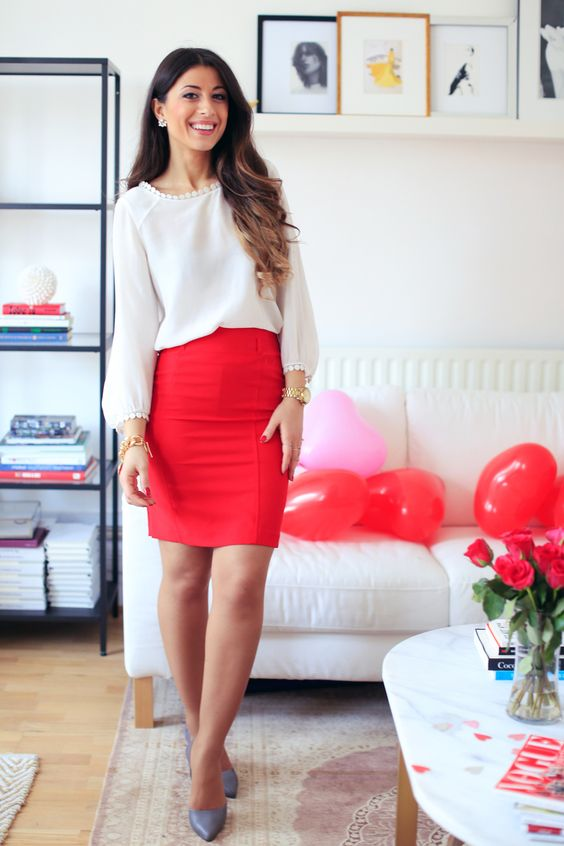 a white shirt with a pompom trim, a red skirt, grey heels for a cute casual look