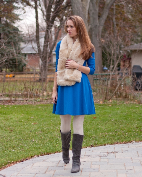 With cobalt blue dress, white tights and gray high boots