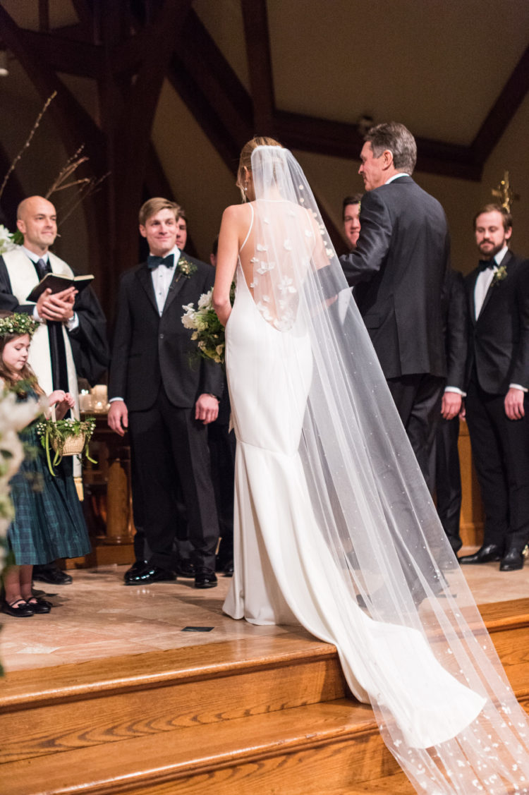 The back of the dress was an illusion one, and the bride chose a proper long veil