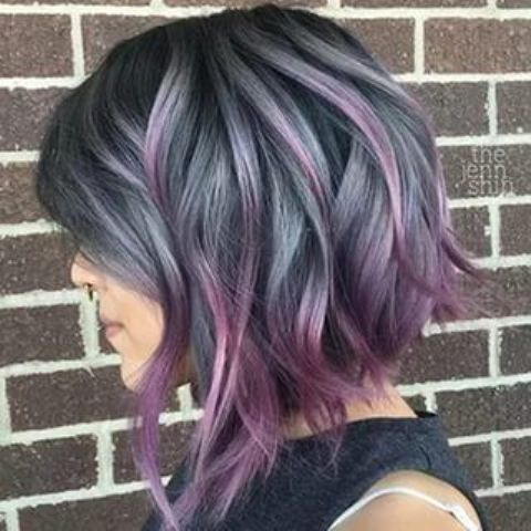 short ashy blue wavy bob with purple balayage looks super bold and attracts attention