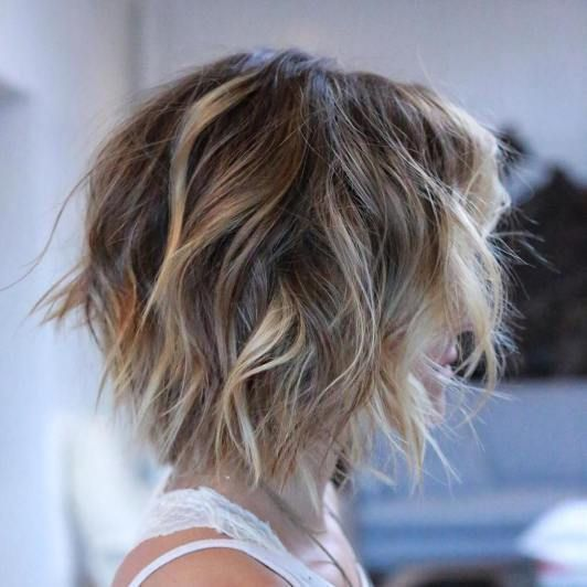 beachy waves on brown short hair plus subtle blonde balayage to get a sunkissed look