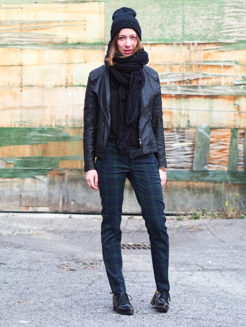 With oversized scarf, beanie, leather jacket and lace up shoes