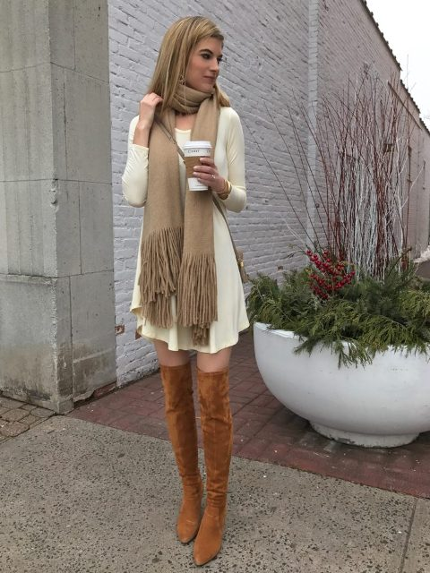 With dress, over the knee boots and crossbody bag