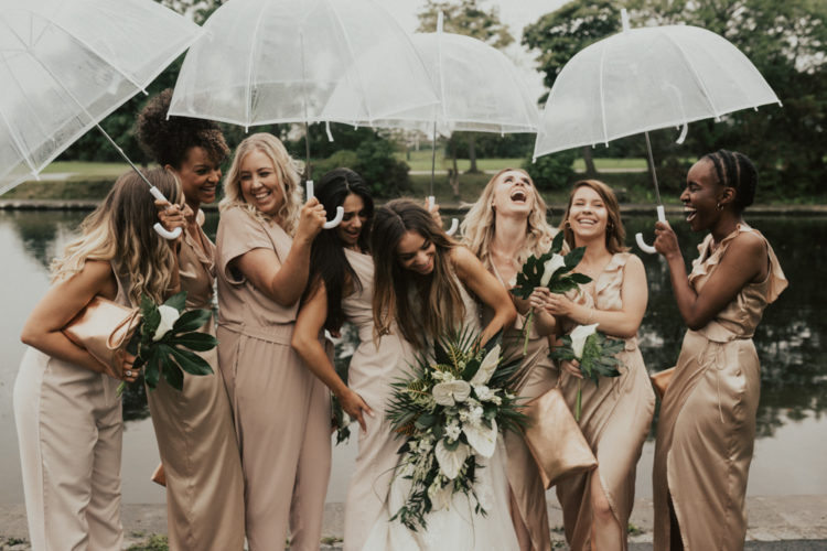 This wedding on a rainy day was filled with tropical leaves and blooms and laughter