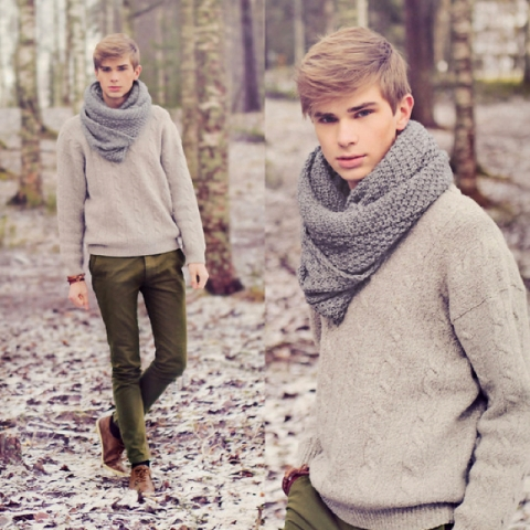 With beige sweater, olive green pants and brown shoes