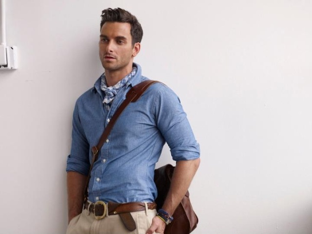 With light blue shirt, beige pants, brown belt and brown bag