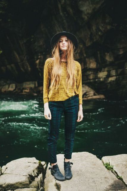 With yellow shirt, wide brim hat and ankle boots