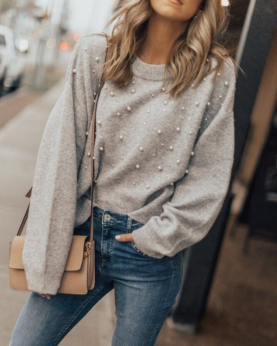 blue denim, a grey pearly sweater and a crossbody bag