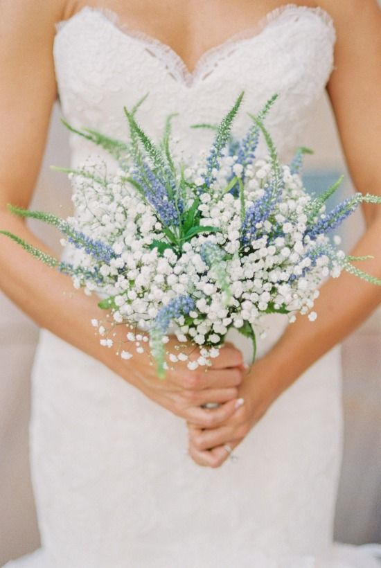 a beautiful bouquet of blue delphinium and baby's breath looks very refreshing and cute