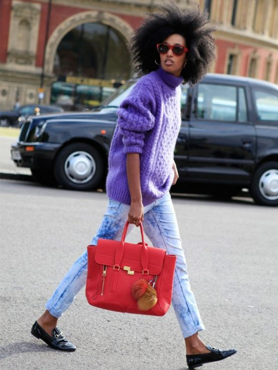 bleached denim, an ultraviolet sweater, black flats and a red bag for a colorful look