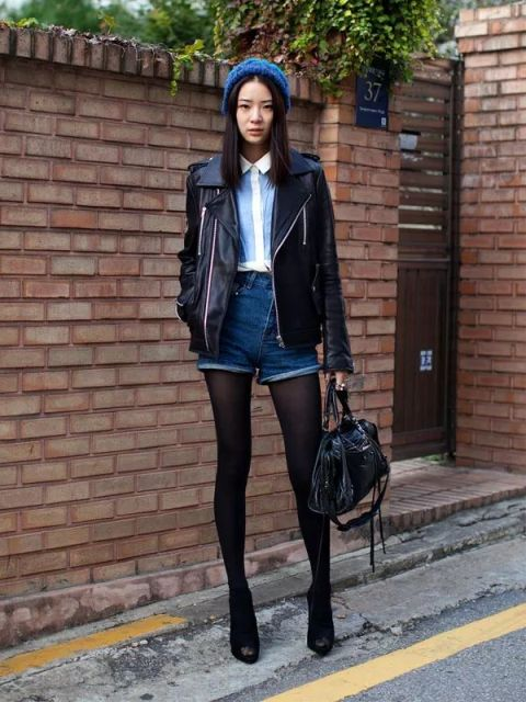 With white and light blue shirt, leather jacket, beanie, black leather bag and ankle boots