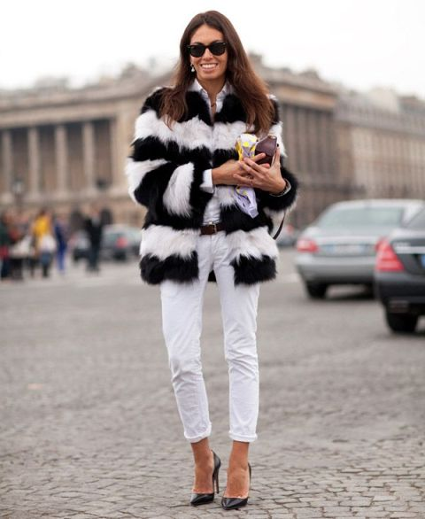 With white shirt, white cuffed pants, heels and clutch
