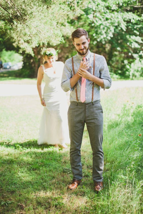 grey pants, a light grey shirt, a pink tie, thin leather suspenders and cognac shoes for a rustic backyard celebration