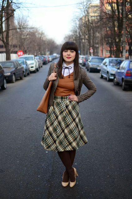 With white shirt, brown sweater, gray jacket, beige shoes and brown tote