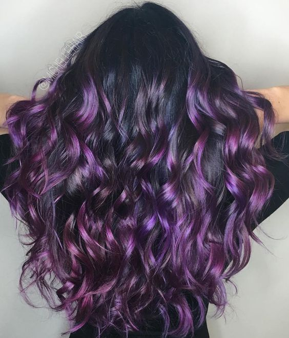 long dark brown wavy hair with purple and fuchsia lowlights and highlights for a glosisng effect