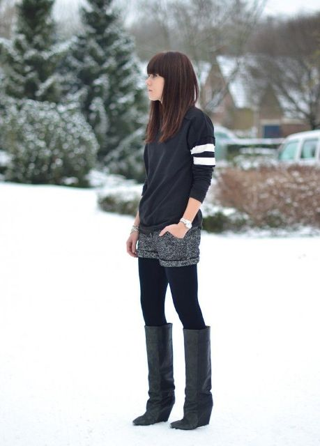 With sweatshirt, black tights and high boots