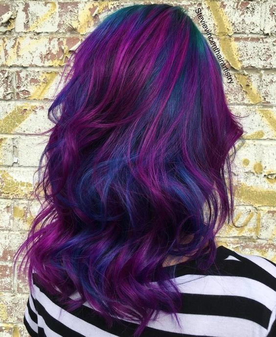 bold blue hair with purple highlights is a crazily bold idea to try